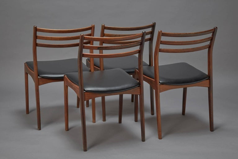 A set of four rosewood dining chairs attributed to Niels Otto Møller similar to his model 78 design, Denmark. Reupholstered in black faux leather, excellent condition.