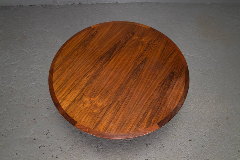 Round rosewood and chrome pedestal base coffee table. Bevelled edge.