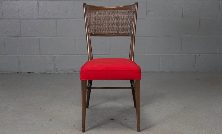 Four caned back chairs designed by Paul McCobb for Directional with new red wool high-quality upholstery.