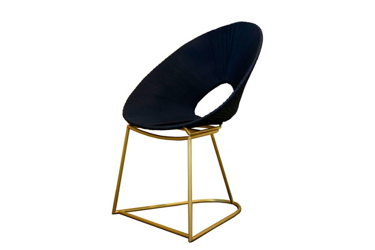 Cacique is a brushed brass structured chair with nylon ropes woven around as a mean to resemble an indigenous feathered headdress, more exactly, the ones made by the Bororo Indians.   As concepts and ideas go along with the products they