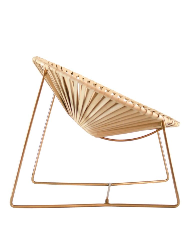 This chair is a unique creation by Leon Leon Design from Mexico City, a modern version of the famous Acapulco chair with a wider and more inclined seat and new materials.