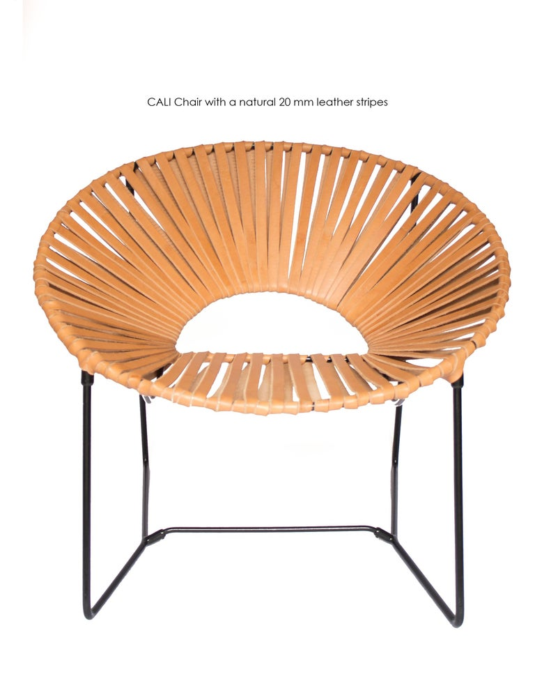 This handwoven midcentury inspired Cali lounge chair is a unique creation by Leon Leon Design from Mexico City, a modern version of the famous Acapulco chair.  It features a solid powder-coated steel structure and a handwoven natural leather