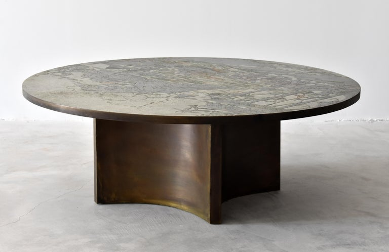 A rare and possibly custom ordered round coffee table / cocktail table by Philip & Kelvin LaVerne. The top has an Asian motif similar to that of the
