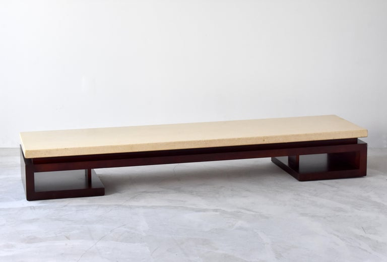 An all original coffee or cocktail table designed by Paul Frankl and produced by Johnson Furniture Company in the 1940s. An off-white/yellow painted cork-top is mounted on a base in dark stained mahogany.  Other American designers include T.H.