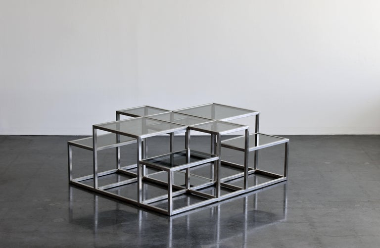 A large sculptural, minimalist coffee table by Michel Boyer in stainless steel with smoked glass plates. The form bears similarity to minimalist works, such as those by Sol Lewitt.   Michel Boyer is one of many important designers working in metal.