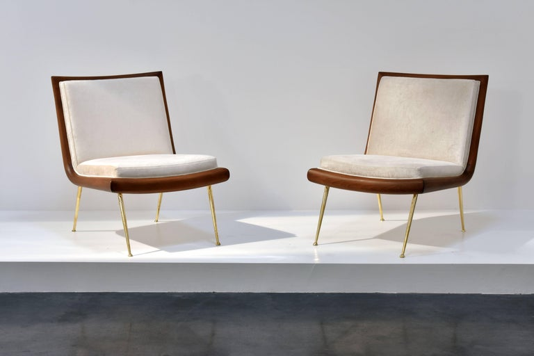 A rare pair of elegant cocktail chairs or slipper chairs designed by T.H. Robsjohn-Gibbings. The dark walnut provides an elegant contrast to the light beige velvet fabric and polished brass legs. Manufactured by The Widdicomb Furniture Company.
