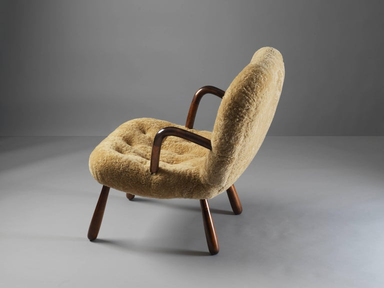 Scandinavian Modern Philip Arctander ( attributed) Clam Armchair Lambskin and Stained Wood, 1940s For Sale