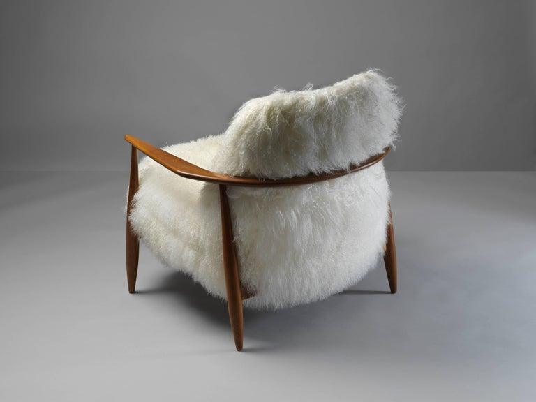 Swedish Ib Kofod-Larsen Attributed, Lounge Chair in White Lambskin, Stained Oak, 1950s For Sale