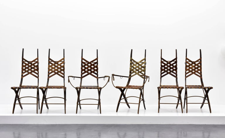 A dining group or side chairs by Italian designer Alberto Marconetti, Italian, 1960s design incepted in Milan in a similar vein as works by Gabriella Crespi and Carlo Bugatti. Executed in Iron, oak, leather, and hand signed as illustrated in the