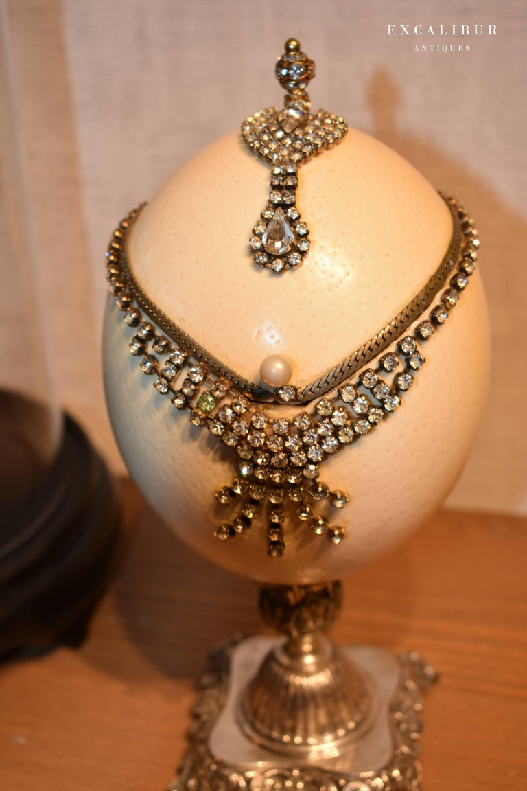 Carved Antique Mounted Ostrich Egg Box Decorated with Rhinestones under a Glass Dome For Sale