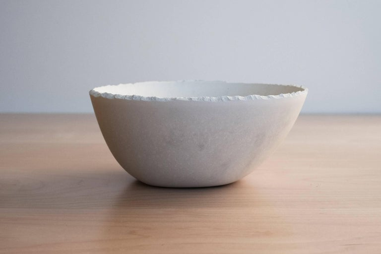 A collection of 200 unique bowls, the Concrete Series by UMÉ Studio expresses the tension between heavy concrete and its delicate edge generated by hand pouring. While one assumes concrete should be strong and durable, it is, at its core, fragile.
