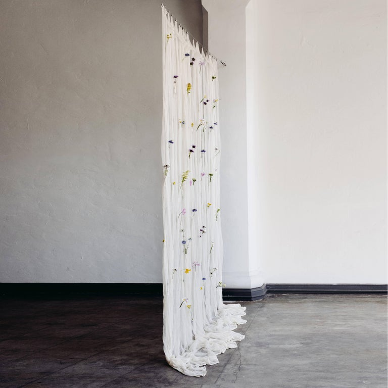 An ever-changing living vertical divider, the draped flowers curtain contains over 100 pockets where fresh flowers can be placed, transforming the space it inhabits by offering a landscape of seasonality and personal contexts.  The limited run of