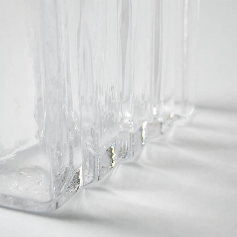 The glass vase is unique, handblown and created by using geometric 'step' proportions inspired by stairwells within the 'Reid' building for The Glasgow school of Art. Designed by eminent architect Steven holl, the step proportions mirror the
