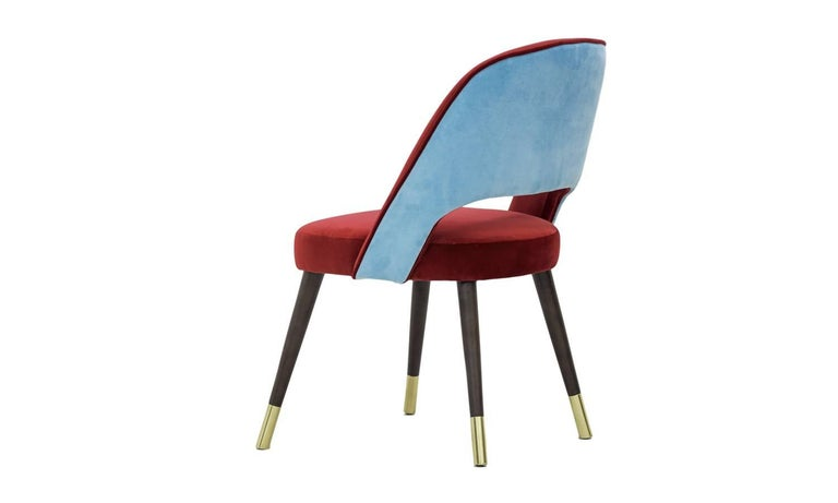 So colorful that nobody could forget it. La Habana chair brings the mix of past and present, the salsa energy and a captivating charm. Prepare yourself for a long, slow seduction.  Made of solid wood with brass sabots. Upholstery: Cranberry and
