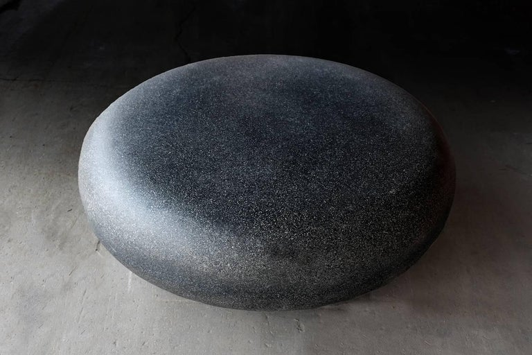 """The Pebble table is an elegant cocktail table with an organic form. Pictured in our Coal Stone finish, the texture and modern look of concrete make it appropriate for a wide variety of styles and spaces.  The Pebble table (ZBT416) is 48"""" in diameter"""