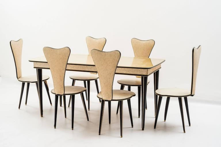 Available the complete dining suite: Six chairs, bar cabinet, sideboard.
