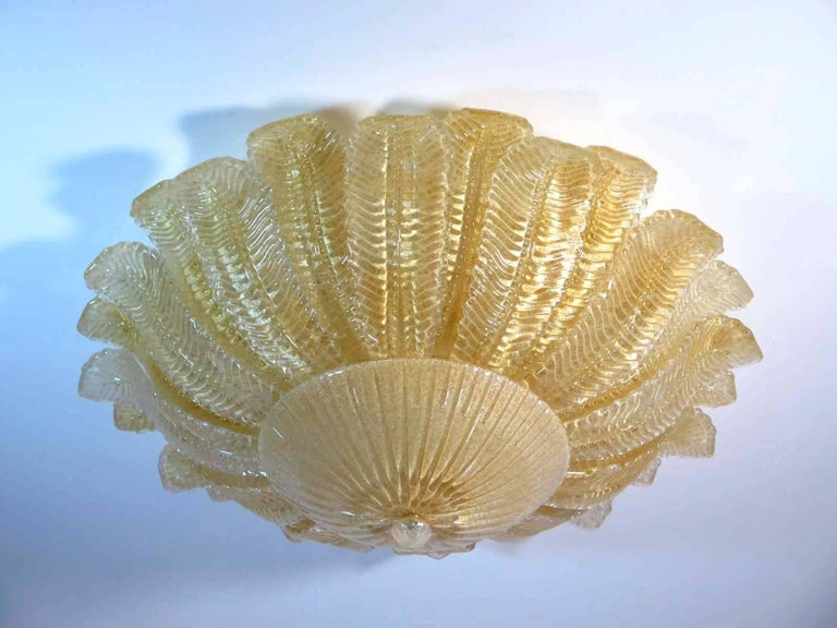 Fantastic and fabulous pair of Barovier and Toso style Murano Italy art glass ceiling lights. The rare lamp is made of 24 mouth-blown hand-formed leaf-form golden powder glass panels plus a huge glass as a bottom. This beauty has the look of a