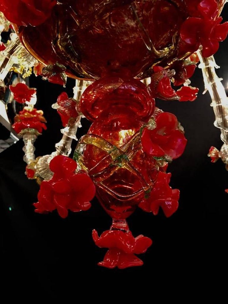 Beautiful Murano chandelier with 24 arms and a multitude of flowers in glass paste and gold inclusion.