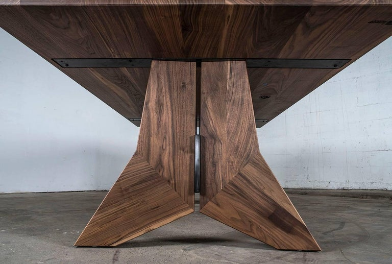 Hardwood and steel modern dining table, the Peralta dining table, is the first new design of 2017. With its sharp angles and the subtle marriage of hot rolled plate steel and Domestic hardwoods, it is a step in a new minimalist direction.  Can be