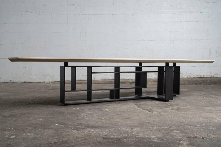 """Modern hardwood and blackened hot rolled steel come together in this incredible statement piece. Made of 1/2"""" by 4"""" hot rolled steel plate this coffee table tips the scale at almost 250 lbs. Inspired by the lines of Pete Mondrian as well as the"""