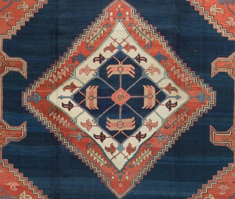 Antique Persian Serapi Rug Carpet circa 1890.The deep blue central medallion surrounds a wonderfully drawn ivory and red pattern, where the blues repeat in the exact center. This is all set on a floral red central field and enclosed by soft blues in