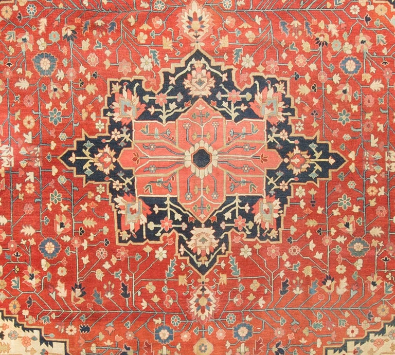 The almost square shape of this rug is so well complimented by the design. The ivory ellipse surrounding the central field accentuates the squarish shape helped by the deep blues in the corners and the lightness of the main border. Serapi is the