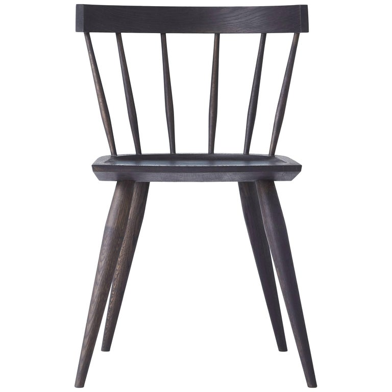 The Edwin chair is a Minimalist take on the classic windsor chair, making it a versatile seating option for any space. Made of select white oak with a hand rubbed black or white (no VOC) oil finish. Each chair is handcrafted and features a deep,