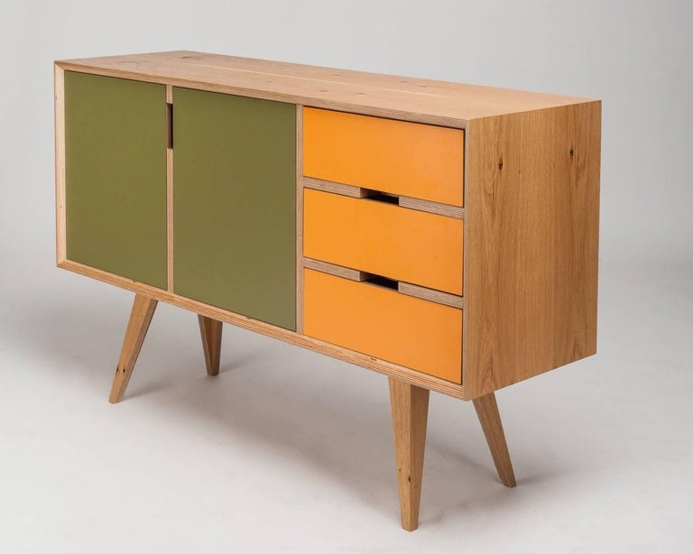 The Otto sideboard is handcrafted and made to order, so veneer finishes, colored door fronts and dimensions can be altered. Seen here in European oak with olive green and yellowy orange. Please enquire for available colours.