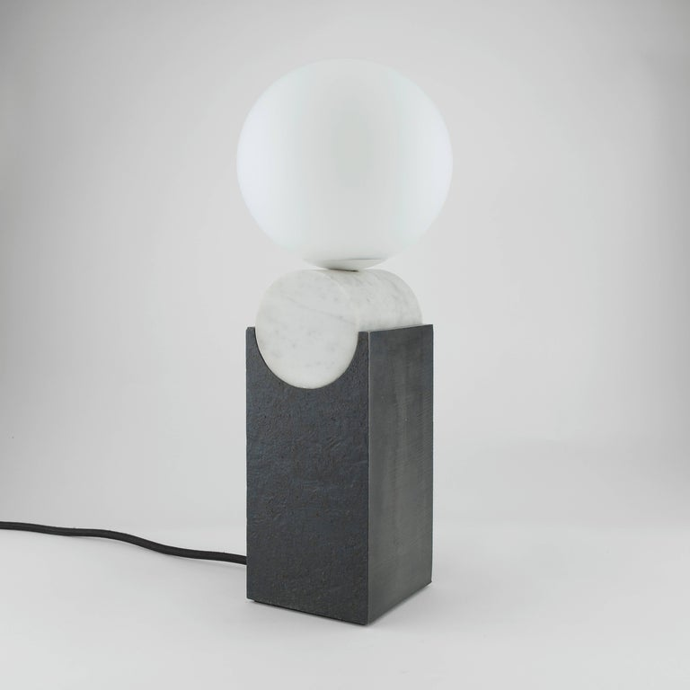 Louis Jobst' Monument Lamps are high quality, bespoke and handmade using solid raw materials. The bases are finished with a black patina and cut from 90mm thick steel billet. Markings from the process are visible and intentionally left, exposing the