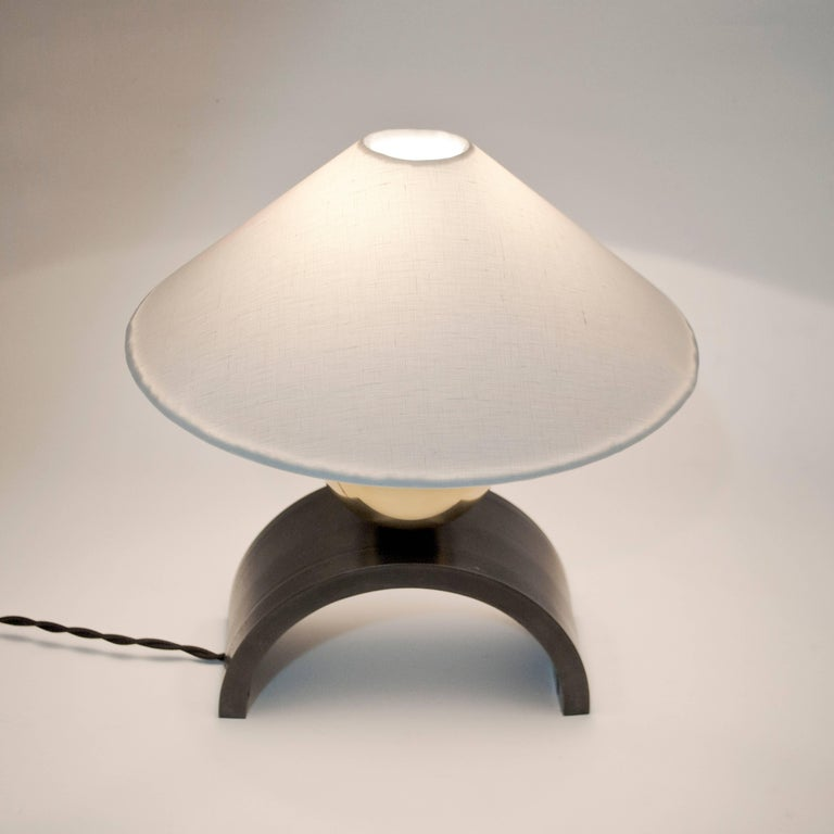 Patinated Contemporary U Lamp with Rolled Steel, Solid Glass and Linen Shade For Sale