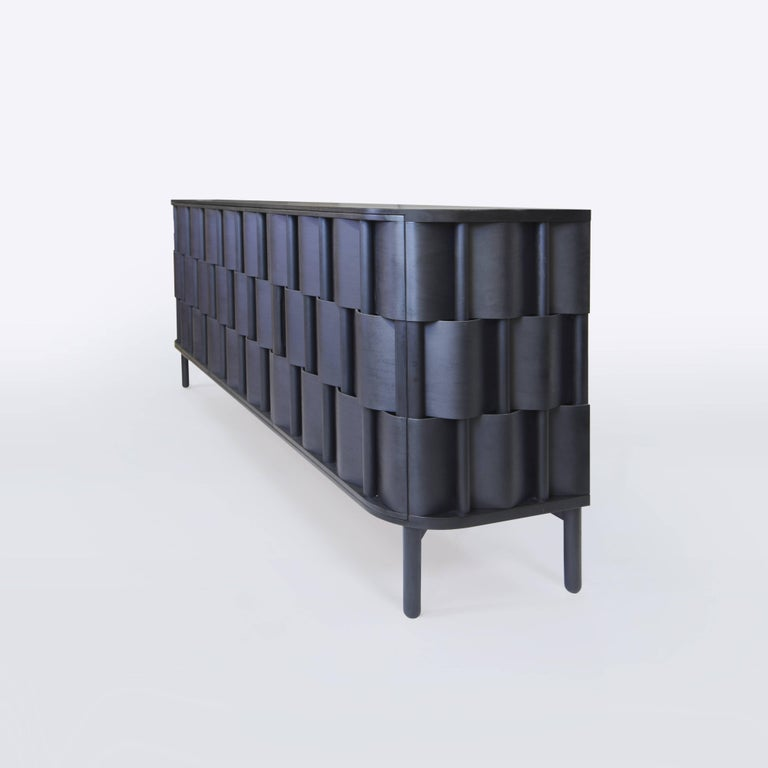 Weave W196-Black Black sideboard, made of solid birchwood and laminated birchveneér. Modern yet classic, bold yet modest the cabinet serves as a great example of scandinavian contemporary design. Designed by Lukas Dahlén.  The minimal yet expressive