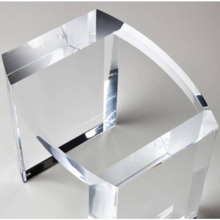 This solid Italian acrylic side table has a unique tear drop shape and elegant thick legs that make them a perfect addition to any type of design. Contemporary or modern, but also paired with traditional or Asian furniture.  Measures: 20 W, 16 D,