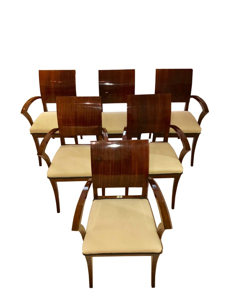 Wonderful set of Six elegant and rare Art Deco armchairs of very modern design. Especially the line management of the conical armrests makes them very interesting and light. The curved back is rosewood/palisander veneer front and back, while the