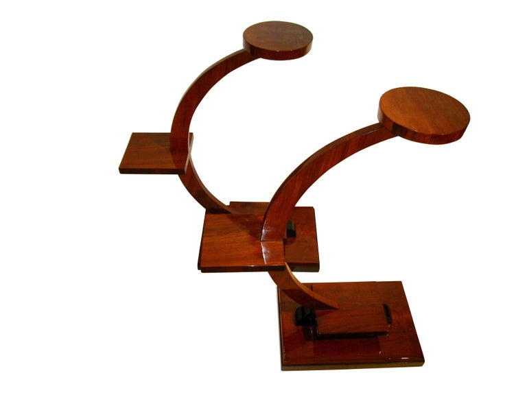 Architecturally interesting Pair of Side Tables for tray or flowers from France, circa 1925.  Curved stand veneered in walnut with some ebonized parts. Hand-polished with shellac (French polish).   The stands were used for placing plants on the
