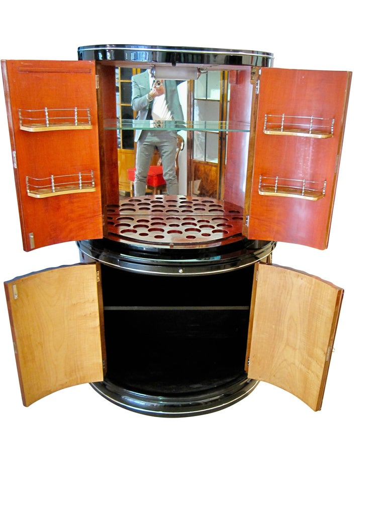 Exceptional Art Deco Demi-Lune Bar / Drinks Cabinet by 'Harry & Lou Epstein Furniture Co.'.   The bar has four cannelured and fluted doors and is veneered in flamed maple, steamed in a walnut brown color tone.  In the upper compartment, there is a