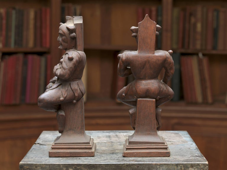 Couple of 19th century wooden jesters on Classic base.
