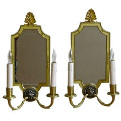 Pair of Mirrored Brass French Empire Style Lion Sconces