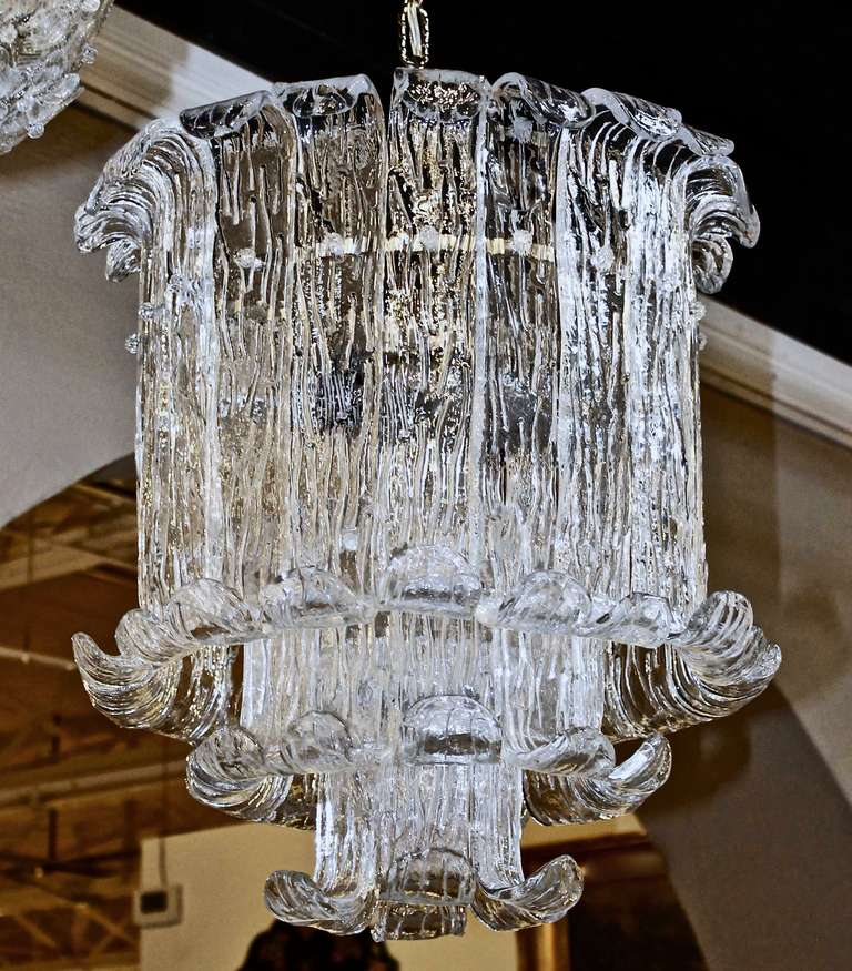 Beautiful Italian thick handblown curved textured glass chandelier by Mazzega. Steel metal frame uses seven 60-watt A size bulbs, newly wired for US. Chandelier size 22