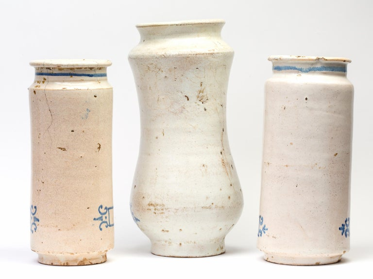 A set of three (3) 18th century glazed ceramic apothecary jars made in Talavera de la Reina, Spain - known for its ceramic tradition since the Roman times. Also called