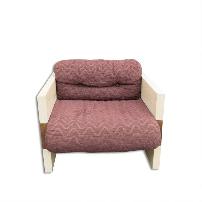 This pair of large armchairs was designed by Albert Leclerc and produced in Italy in the 1970s. The chairs have their original upholstery, as well as plexiglas legs. One armchair has slight damage to the upholstery, see photos. Also missing two