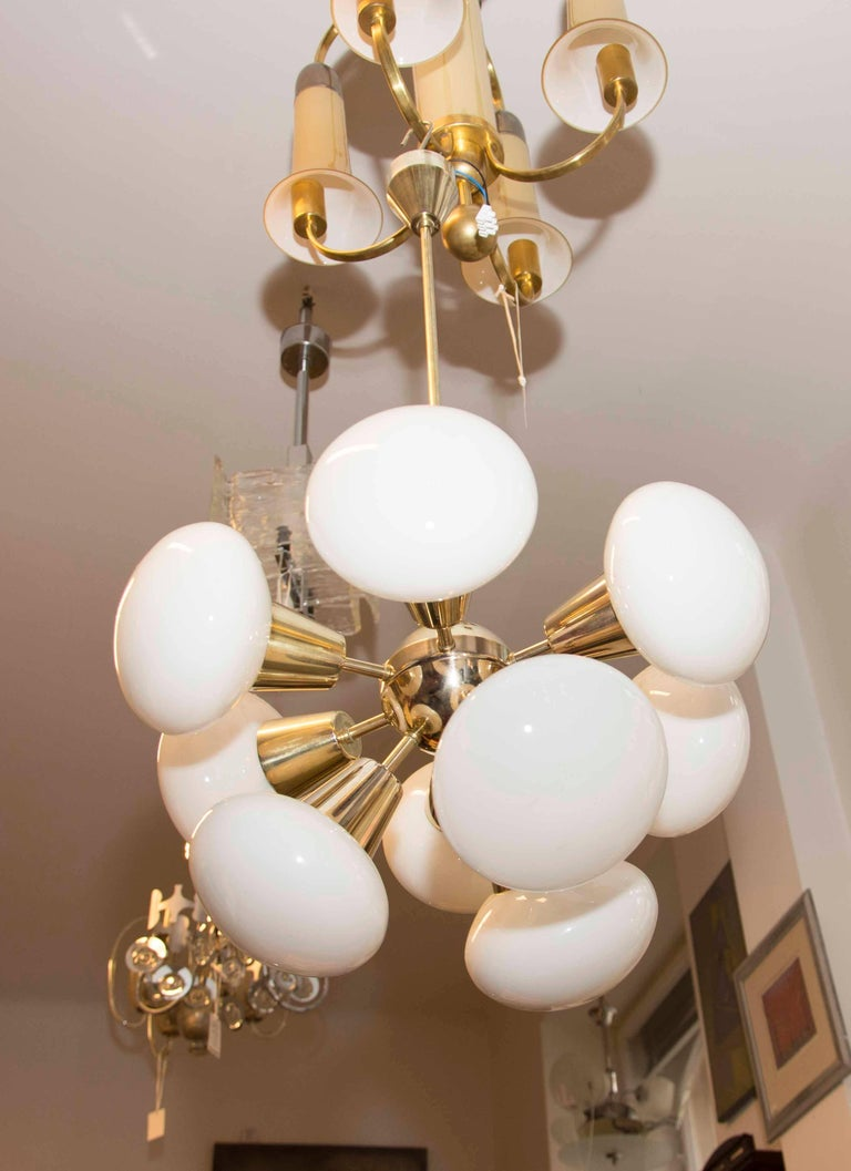"""Czechoslovak milky glass and brass ceiling lamp """"Sputnik"""", made in Czechoslovakia in the 1970s. Manufactured by Kamenicky Šenov. In excellent condition, new wiring.  Total height: 87 cm  width: 48 cm."""