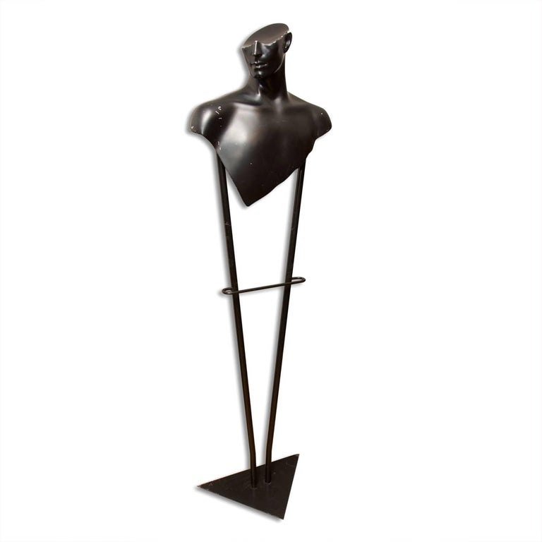 An exceptional design mid-century Valet stand made in Czechoslovakia in the 1970s. The stand was made for the Prague fashion house. It is made of iron and plastic. It bears some signs of wear through a minor scratches and abrasions, but overall is