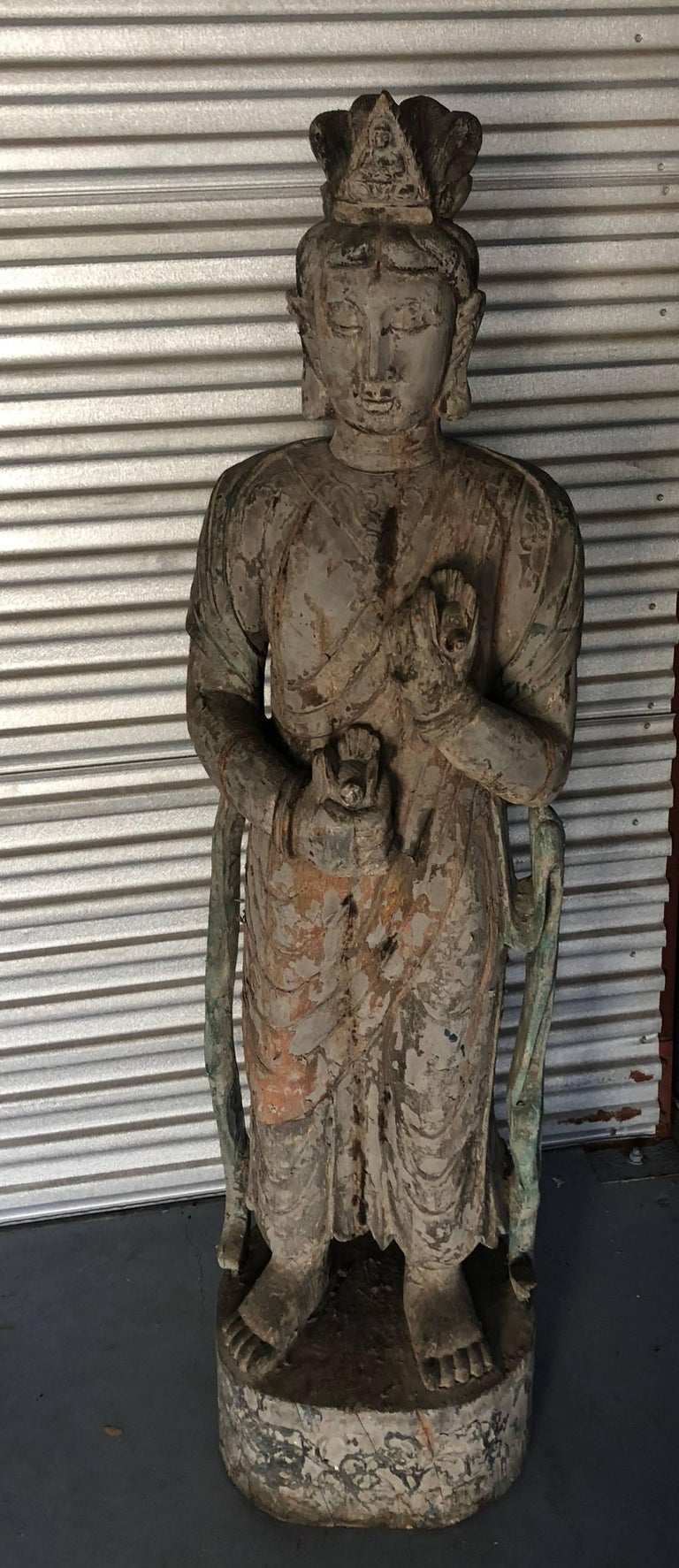 This Ming dynasty style Guan Yin statue is hand-carved, wooden and has been finished with a green lacquer Please see the enclosed certificate I received from the Veng Son Art Craft Company 10/12/02. She has birds in hand and ribbons flowing from her