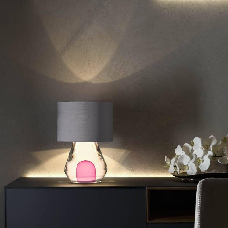 New Born is from our contemporary Sommerso collection of table lamps. The minimal design requires exceptional mastery of glass, which is free-blown (no mould is used) by ARS Murano. It was designed by the prize-winning BrogliatoTraverso studio in