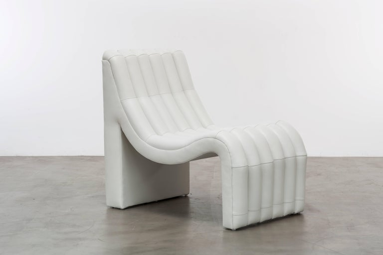 The Sacha chair features layers of channelled leather to create a chic and sophisticated sit. This is a showroom sample sold as is. As shown in white leather.