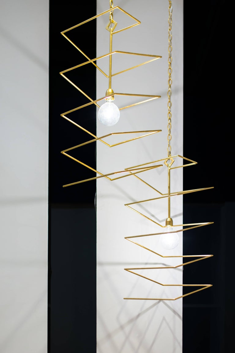 The Valentina pendant features a gold leafed over iron zig-zag design. Light bulbs: One clear globe g40 standard base 60 watt max (not included). This is a pair of show room samples sold as is. CSA listed.
