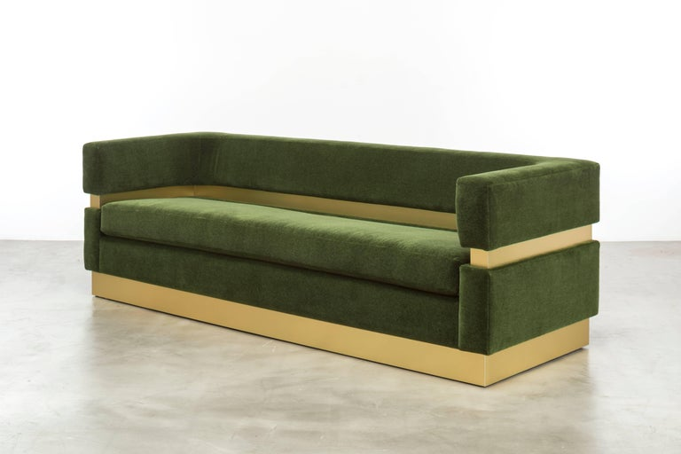The Cardin Sofa features layers of upholstery and metal inlay to create a minimal and modern sitting statement.  Fully custom and made to order in California. As shown in Mohair $18,075.00.  Starting at $12,875.00.