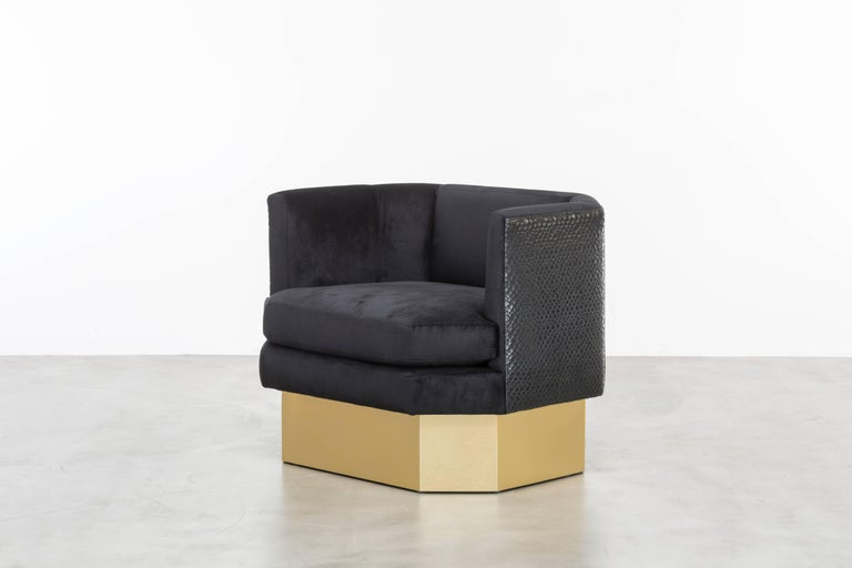 The Octave Chair features an octagonal shaped upholstered velvet seat and back with contrast leather back panels floating upon a brushed brass plinth base.  Fully custom and made to order in California.  As shown in European Velvet and Contrast