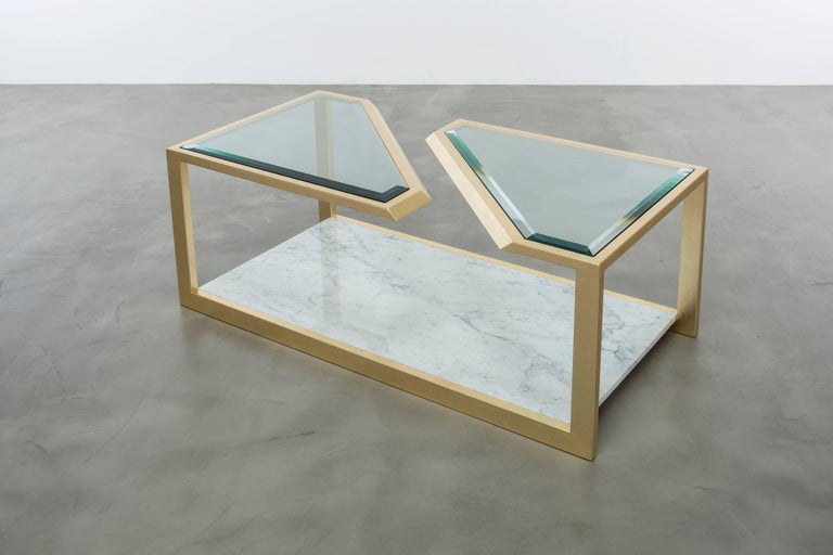 The Pierre coffee table is a modern fractured gold leaf cocktail table made of gold leaf over iron with Carrara marble and bevelled edge glass. Winner of the ASFD 2016, Pinnacle Award for best occasional table, this coffee table is a real statement