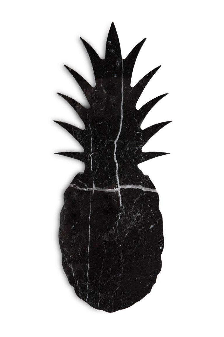Small black marble paperweight with pineapple shape. Each piece is in a way unique (every marble block is different in veins and shades) and handmade by Italian artisans specialized over generations in processing marble. Slight variations in shape,